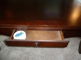"Large dark cherry coffee table with two drawers by Bassett.  48"" x 32"""