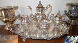 "Silverplate tea service (mark on left is on tray, mark on right ""silver on copper"" is on the teapot & bowls."