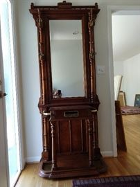 Wonderful vintage mahogany hall tree, with a mail slot, not female.