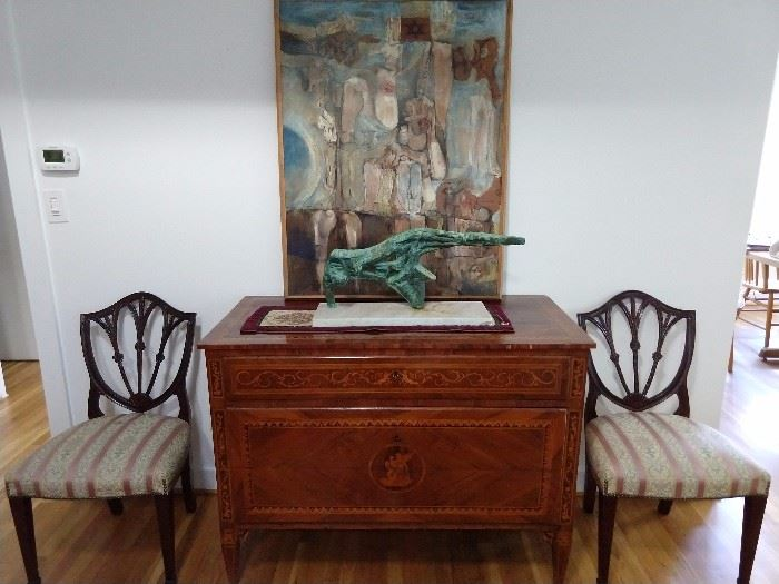 BEAUTIFUL  inlaid French commode, with copper figure on white marble base, overlorded by an original oil on canvas, flanked b y a pair of mahogany side chairs.