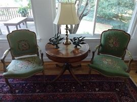 LOVE these hand embroidered French bergere armchairs making an Oreo out of a leather-topped mahogany drum table.