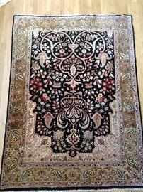 Beautiful Persian silk rug, hand woven, measures 5' x 7'.