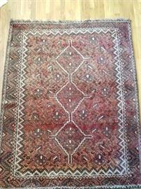 Tribal Persian rug, 100% wool, hand woven, measures 6' x 9'.