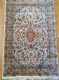 """Lovely Persian silk rug, hand woven, measures 5' 5"""" x 7' 8""""."""