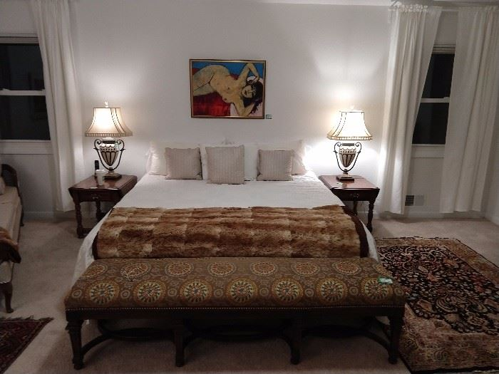 King size bed, with all linens, authentic alpaca fur quilt (one of two), with an antique English mahogany bench, pair of vintage oak side tables, pair of decent table lamps, vintage silk Persian rug and romance-inducing red-hot mama above the bed, by none other than a local boy-done-good-artist, Jim McRae