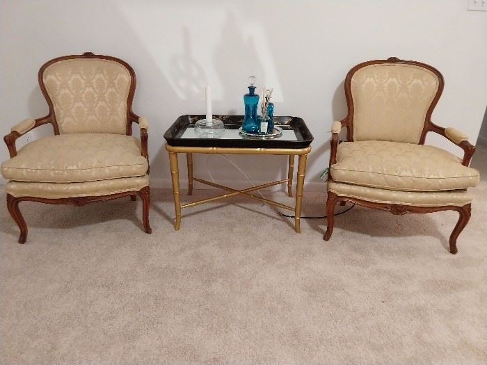 Very nice pair of French bergere chairs, with down cushions, faux bamboo coffee table.