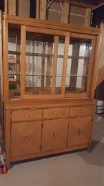 $100   Natural finish china display cabinet