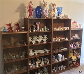 Hundreds of porcelain collectibles: salt & pepper shakers, button down shoes, porcelain clowns, vases, candle sticks, glasses, and more.