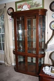 Beautiful wood and curved glass curio cabinet