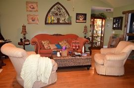 This house is packed full! Arched back sofa, 2 comfortable side chairs; coffee table with storage; many decorator accessories.