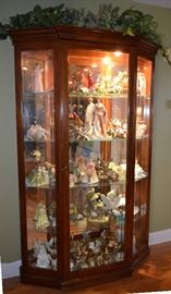 Large display cabinet with lights, back mirror & glass shelving.