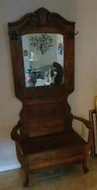 Beautiful antique hall mirror with settee.