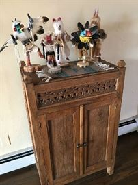 Kachinas and rustic cupboard