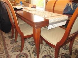Like new dining table w/ 2 leaves and pads. 6 chairs