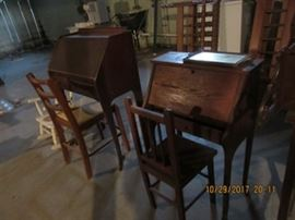 Two children's desks. Both are oak and have fall front lids with drawer beneath.  The interiors are fitted.