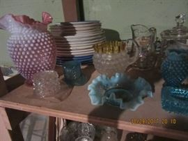 A view of some of the glass in the sale Pressed, hobnail, and plates.