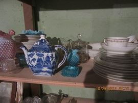 Willow teapots.  on the right is another set of dishes.