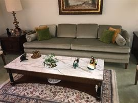 Marble topped coffee table, couch, area rug and decor
