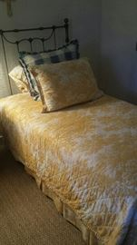 pair of fabulous iron twin beds with great bedding