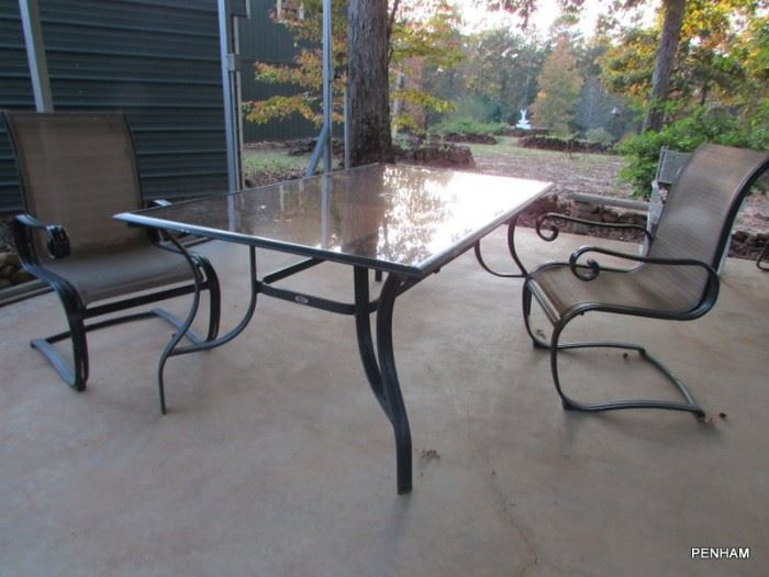 Glass top table w/4 matching chairs. Hole in center of table for umbrella