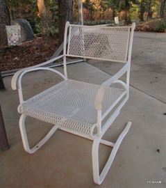 Several white metal chairs available