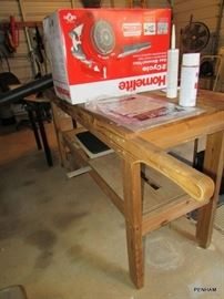 This is a great idea....work table on (round wood front wheels) wheels, roll to where you need it most.