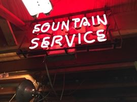 neon Fountain Service sign