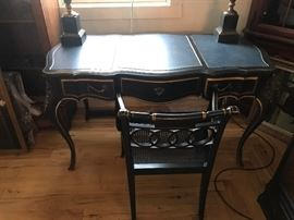 Beautiful Drexel Neo Classical  black french desk with  gold leaf trim,  brass drawer pulls and corner peices with nice patina,  a blue green leather top. Drawers have velvet lining. Final Sale Price $ 295.00                               Class Act!!