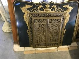 1890,s Exquisite Antique Fireplace Screen made of metal and exqiusite brass. Doors open in the front for loading fire wood.  Rare and one of a kind find , from Rome shipped back from the client.   It's a real deal at   $900.00  or best offer