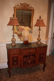 Decorative Mirror, Antique Inlaid Cabinet with Marquetry, Pair of Lamps and Floral Arrangement