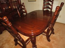 By Singer Furniture Co Beautiful Canonball Dining table and chairs with 2 extra leaves.