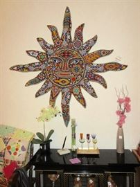 Mexican folk art, a huge wall hanging of the sun, all bead work.