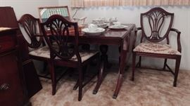 Drop-leaf Table by Bernhardt Furniture Co. Has 6 Chairs, and Comes with 3 Leafs, and Table Covers.