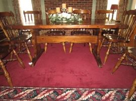 Solid Pine trestle table with bread board ends, 2 leaves, and 9 chairs