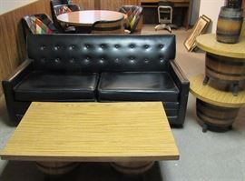 Black vinyl two seater love seat, barrel end and coffee tables, barrel lamps