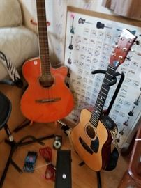 Guitars, cases, electric guitar foot pedal, music books
