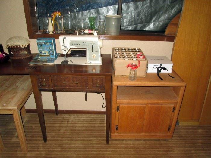 Basement:  TV stand, Singer sewing machine, Box of small bottles, White box