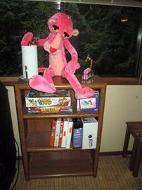 Basement:  Stuffed Pink Panther, Shelf unit, Games