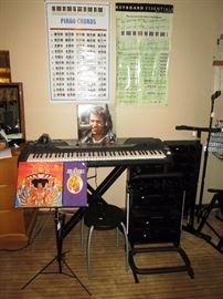 Basement:  Yahama KeyBoard psr-Gx76 Jimi Hendrix LP & CD set, Black Music Stand, 4 Guitar Stand,