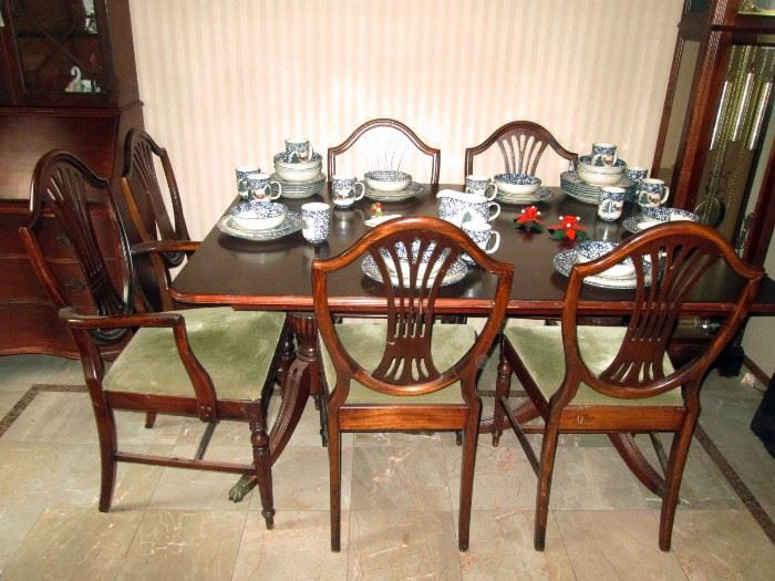 Dining Room: Duncan Phyfe Style Dining--5 chairs, (1Captain's Chair), 1 leaf, Protective Cover