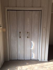 Faux painted doors and wood paneling.