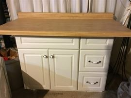 "-Cabinet and top are not attached; cabinet measures 30 1/2"" tall, 36"" long, and 22"" deep; top measures 4"" tall, 48 1/2"" long, and 25"" deep"