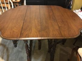 "-kitchen table with drop-leaf sides; measures 29 1/2"" tall, 42 1/2"" wide, and 54 1/2"" long with sides up, 20"" long with sides down"