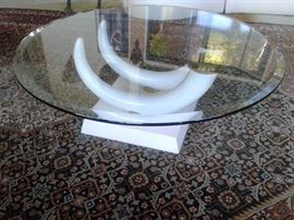 Elephant Tusk Round coffee table, glass top  resin base