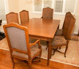 Walnut finish table, six chairs, 2 leaves, table pads included