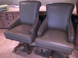 two solid leather rolling barrister desk chairs
