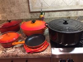 almost new LeCresuet cookware and notice the black one to the right was never used  Thirteen and 1/4 quart dutch oven--It is HUGE!