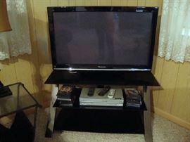 Flat Screen TV,  Stand, DVD Player