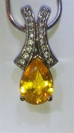 2.58ct yellow sapphire pendant with 18 diamonds - by appointment only
