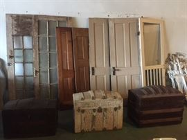 Several Antique Doors and Camel Back Trunks
